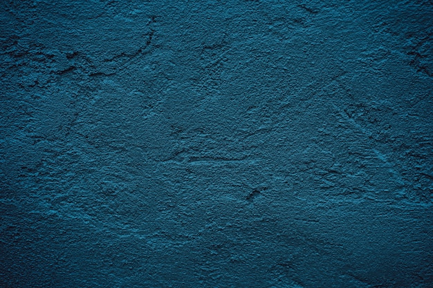 Grunge blue dark cement wall texture background with empty space for text for paper background.