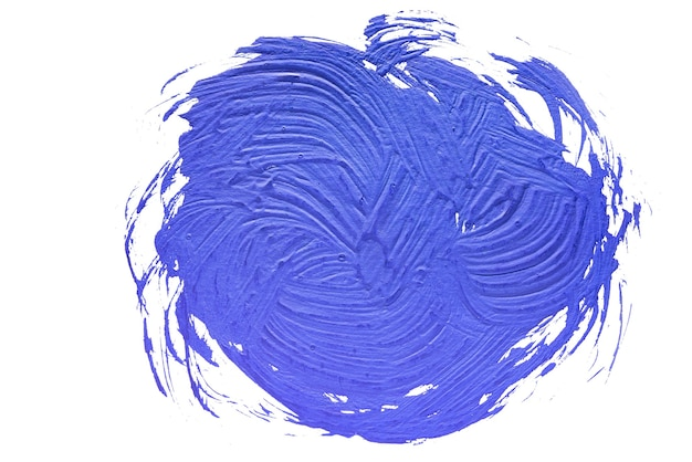 Grunge brush strokes of blue paint on white wall