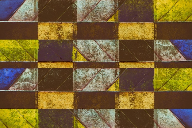 Grunge  colorful  yelow,blue,white and pink geometric  rustic texture wallpaper   background