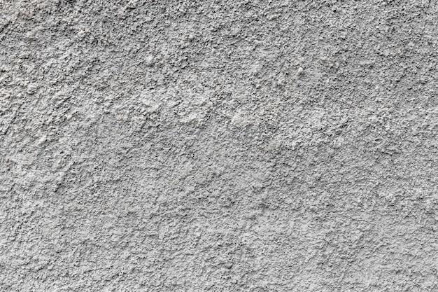 Гранж бетонная цементная стена с трещиной в промышленном здании