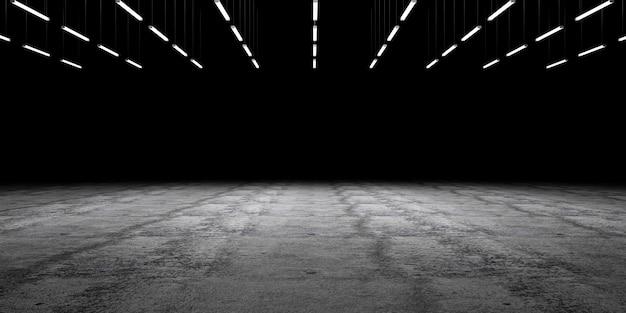 ランプが照らされ、空のスペースとグランジコンクリートの床