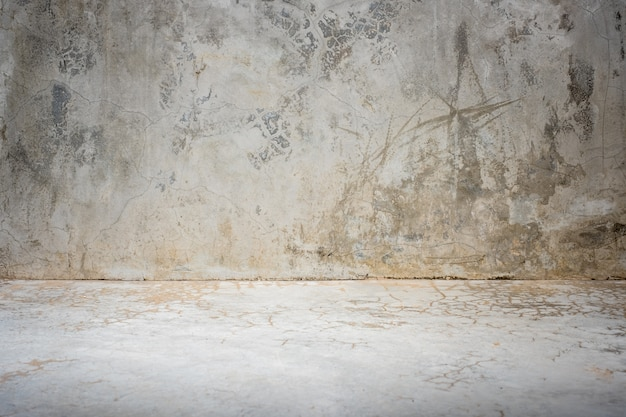 Grunge concrete studio room background with light