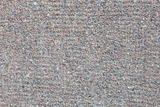 Grunge concrete surface decorated with small pebbles small stones wall texture for background usage rough backdrop abstract pattern buildings facade urban design