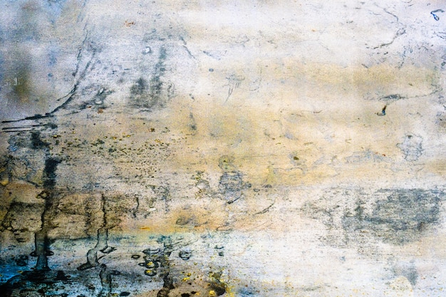 グランジゴールデン乱雑な壁漆喰表面テクスチャ背景。装飾的な壁のペンキ。