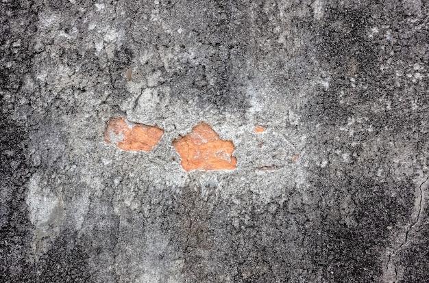 亀裂とレンガとグランジ灰色の壁の背景