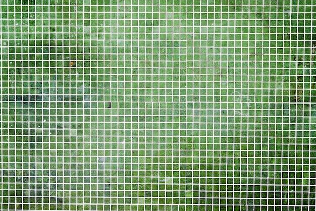 Grunge green mosaic tiles background