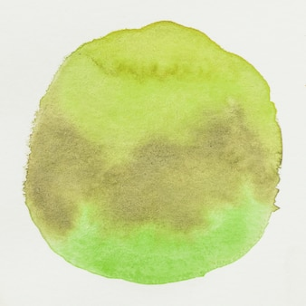Grunge green watercolor stain spot on white canvas background