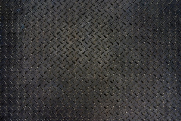 Grunge metal diamond plate floor texture background.