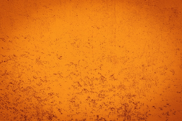 グランジオレンジ色のコンクリートの壁のテクスチャ