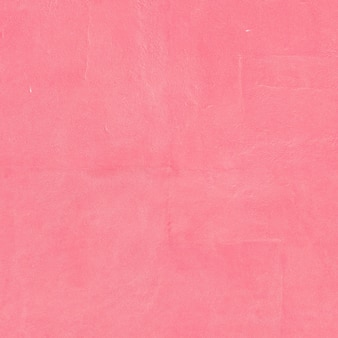 Grunge pink surface. Rough background textured .