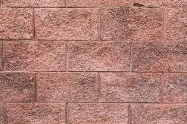 建物の壁の表面、装飾タイルのクローズアップにグランジ赤レンガ