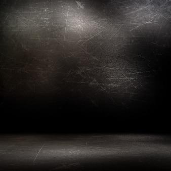 Interno della stanza di lerciume con le pareti e il pavimento graffiati scuri