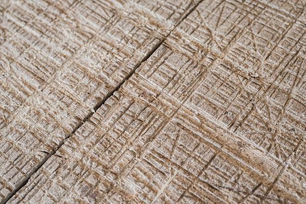 グランジは、木製の表面のテクスチャを傷つけたり、穴をあけました。 Premium写真