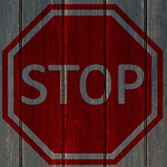 Grunge stop sign on dark wooden plank