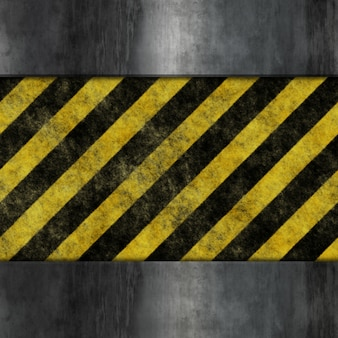 Grunge style metal background with yellow and black warning stripes