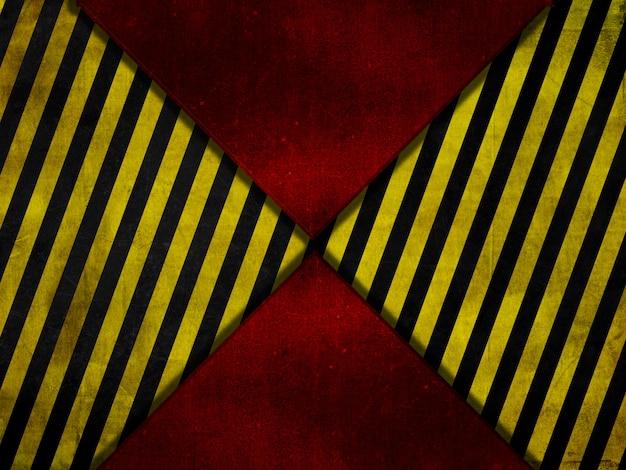 グランジスタイルの赤い金属の背景に黄色と黒の警告ストライプ