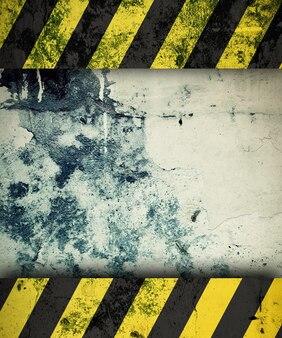 Поверхность гранж с желтыми и черными полосами в качестве фона предупреждения или опасности