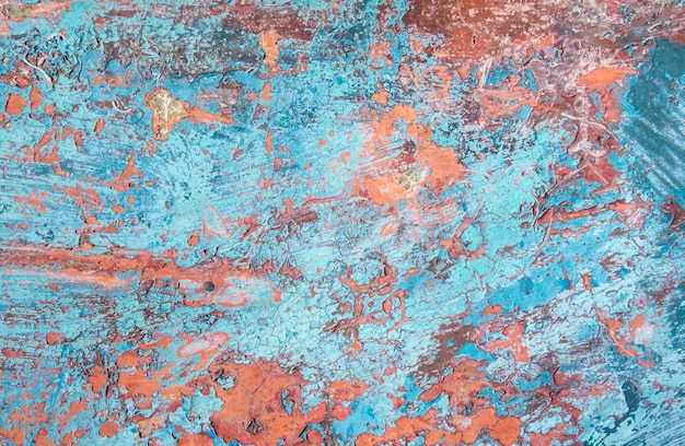 Grunge texture, blue and orange paint peeling from fiberglass surface background