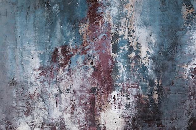グランジテクスチャ壁。青、赤、白の色。ヴィンテージの古いスタイルの部屋のインテリアの要素。