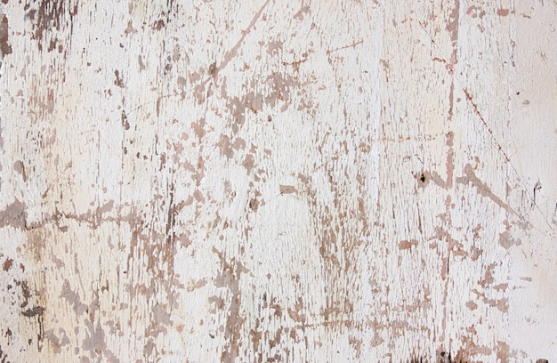 Grunge texture,white paint peeling from wooden surface