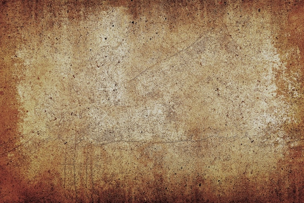 Grunge uneven beige and brown stone texture background with cracks and stains