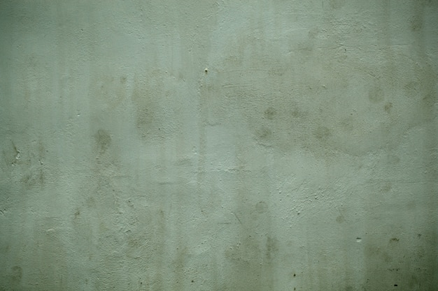Grunge vintage style green painted wall  texture showing weathering of the paint in a full frame view.