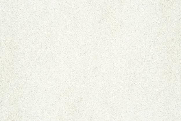 グランジの白い表面。粗い背景のテクスチャ。