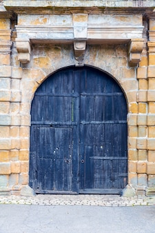 Grunge wooden door, ancient european tourist city. summer tourism and travels, famous europe landmark, popular places for travelling