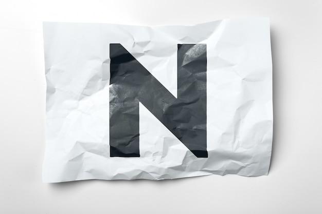 Grunge wrinkled paper letters on white