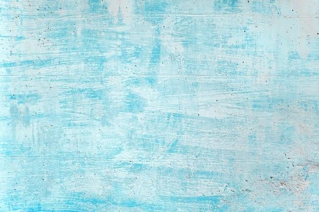 Краска цвета моря пустой бетонной стены grunge голубая для текстуры. старинный фон