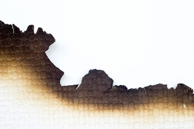 Бумага сгорела старая текстура grunge абстрактная