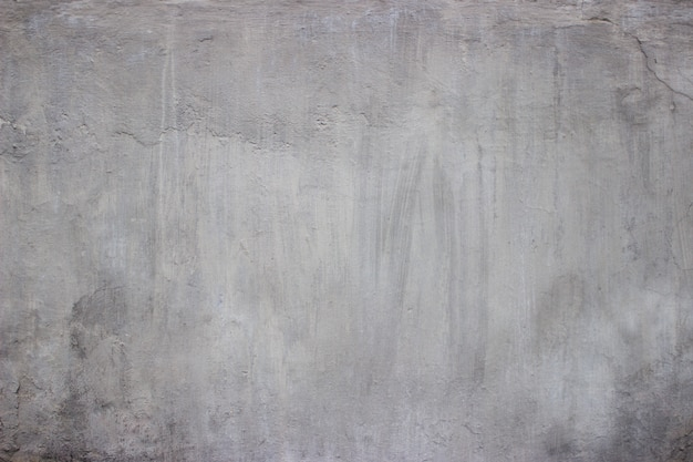 Grungy concrete wall and floor as background.