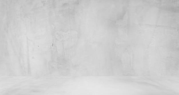 レトロなパターンの壁としての天然セメントまたは石の古いテクスチャの汚れた白い背景。概念的な壁のバナー、グランジ、素材、または建設。