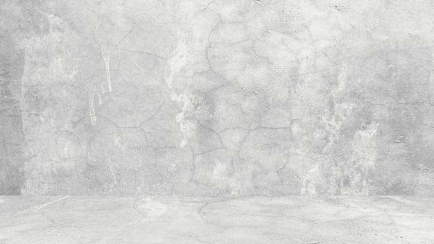レトロなパターンの壁の概念的な壁のバナーグランジマテリアルまたは建設としての天然セメントまたは石の古いテクスチャの汚れた白い背景