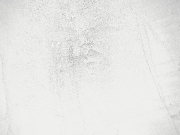 レトロなパターンの壁としての天然セメントまたは石の古いテクスチャの汚れた白い背景
