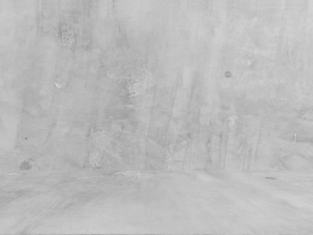 自然なセメントや石の古いテクスチャ壁の汚れた白い壁。概念的な壁バナー、グランジ、材料、または建設。