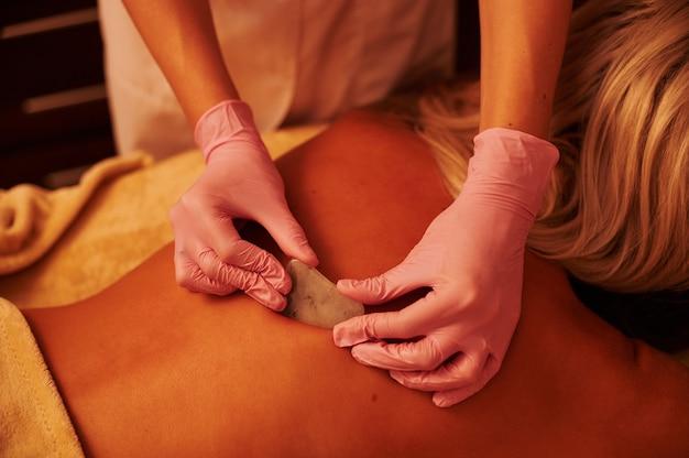 Gua sha acupressure treatment