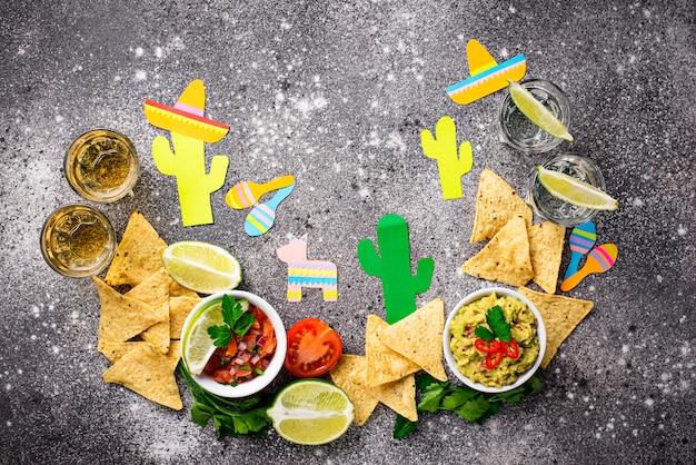 Guacamole, salsa, nachos and tequila