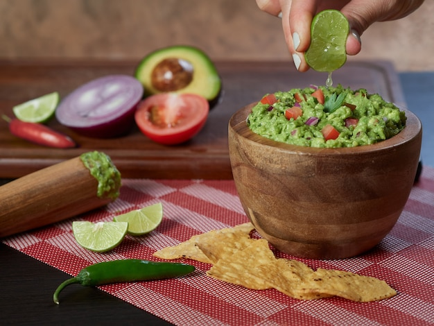 Guacamole traditional mexican food with avocado and vegetables