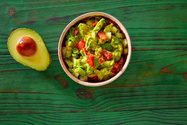 Guacamole with avocado and tomatoes mexican
