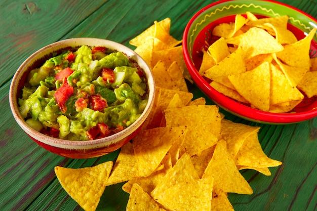 Guacamole with avocado tomatoes and nachos