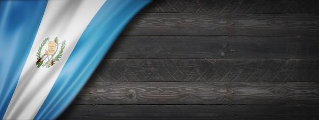 Guatemala flag on black wood wall