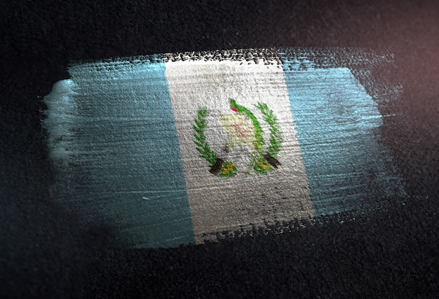 Guatemala flag made of metallic brush paint on grunge dark wall