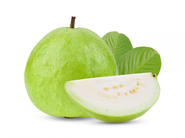Guava fruit with leaves on white wall.