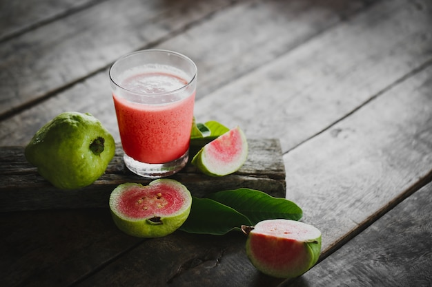 Guava juice with sliced on wood table
