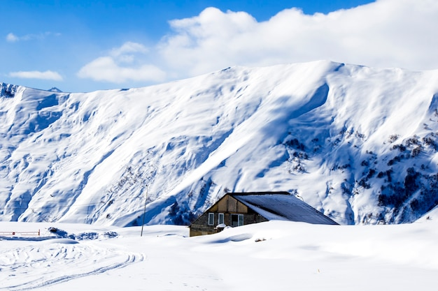 Gudauri, georgia - february 06, 2021: ski resort, snowy mountains and hostels.