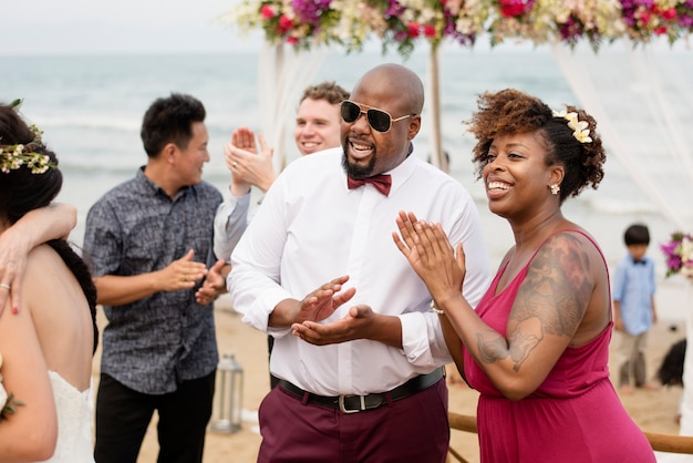 Guests at a beach wedding ceremony