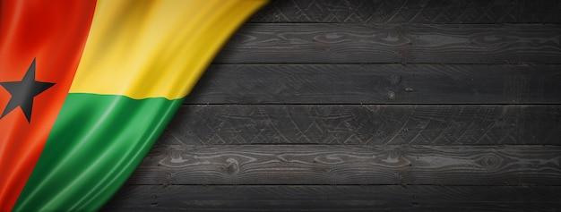 Guinea bissau flag on black wood wall