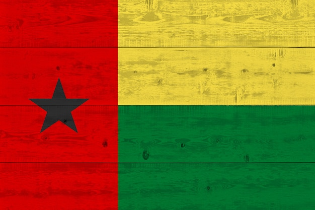 Guinea-bissau flag painted on old wood plank