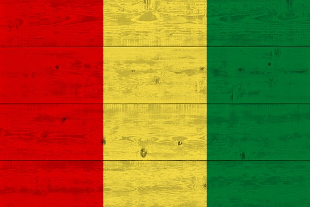 Guinea flag painted on old wood plank